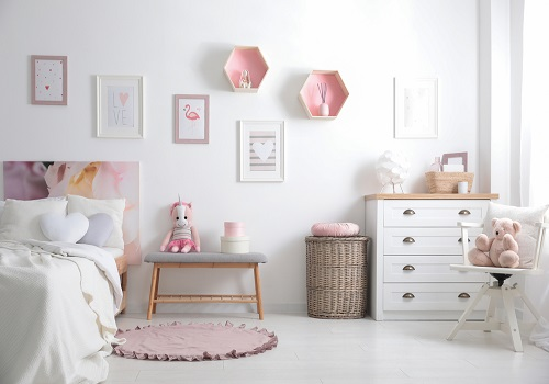 girls bedroom with subtle pink shade