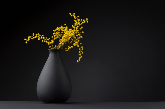 flowers on black vase