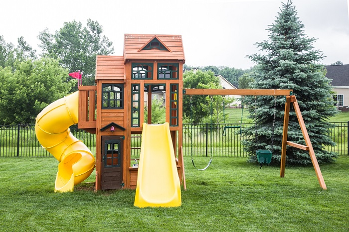 wooden play structure in the backyard